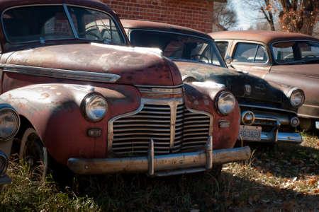 abandoned car: Old cars at the garage in Ramah, Colorado.