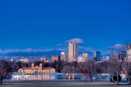 denver skyline with mountains: A view of downtown Denver before sunrise.