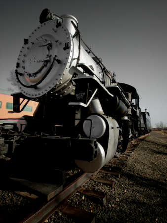colorado railroad museum: Old steam locomotive stretches down the tracks. Editorial