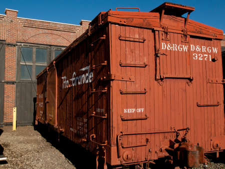 colorado railroad museum: Vintage boxcar built of wood at front of the roundhouse.