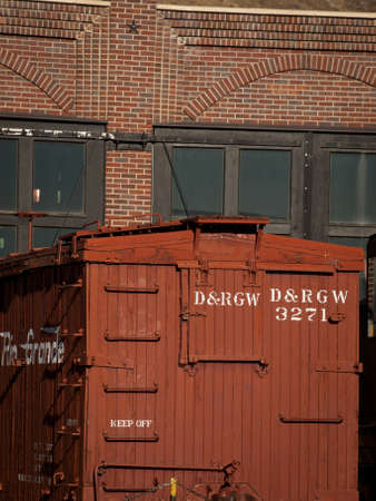 boxcar train: Vintage boxcar built of wood at front of the roundhouse.