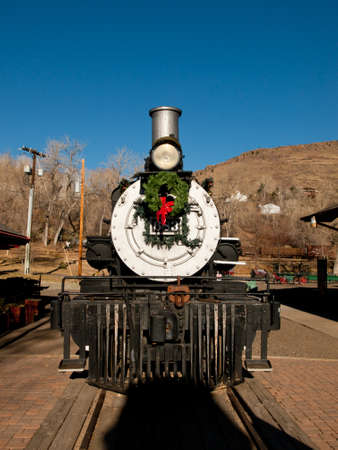 Rio Grande Western 683 locomotive is decorated for Christmas. This is the oldest operating locomotive in Colorado built by Baldwin in 1881.