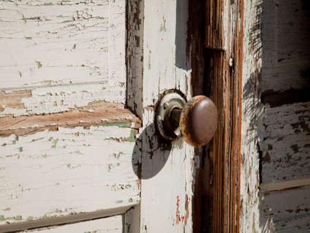 door knob: Rusric door knob on old door. Stock Photo