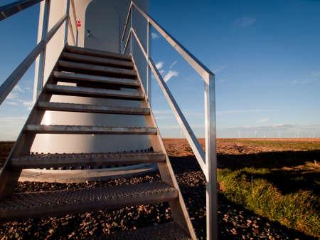 Wind turbines farm at sunset in Limon, Colorado. Stock Photo - 11421685