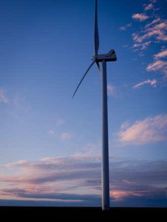 Wind turbines farm at sunset in Limon, Colorado. photo