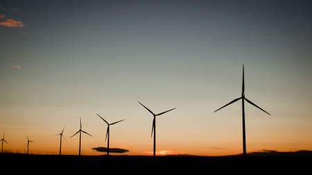 Wind turbines farm at sunset in Limon, Colorado. photo
