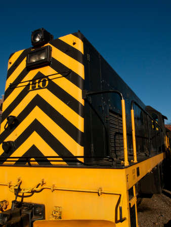 colorado railroad museum: Vintage yellow locomotive at front of the roundhouse.