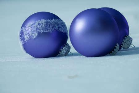 Christmas ornaments in virgin snow. Stock Photo