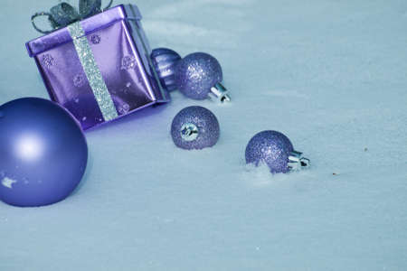 Christmas ornaments in virgin snow. photo