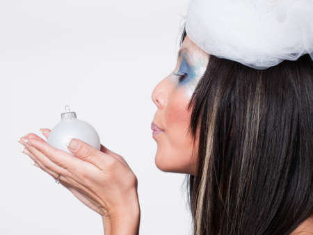 Ice queen - beautiful woman in winter professional makeup. photo