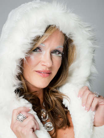 Ice queen - beautiful woman in winter professional makeup. Stock Photo