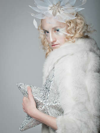 Ice queen - beautiful woman in 'winter' professional makeup. photo