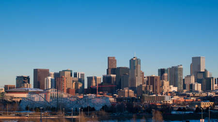 denver skyline at sunset: A view of Denver, Colorado downtown at sunset.