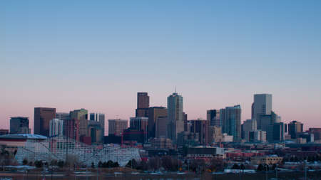 A view of Denver, Colorado downtown at sunset.