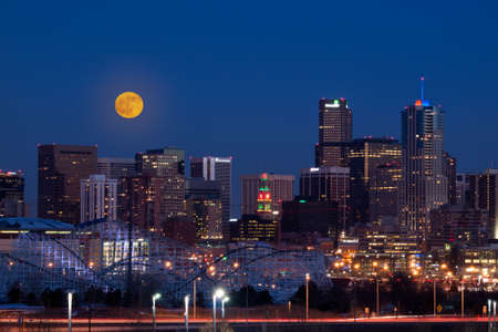 denver skyline: A view of Denver, Colorado downtown with full moon.