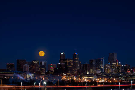 colorado rockies: A view of Denver, Colorado downtown with full moon.