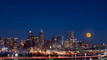 A view of Denver, Colorado downtown with full moon.
