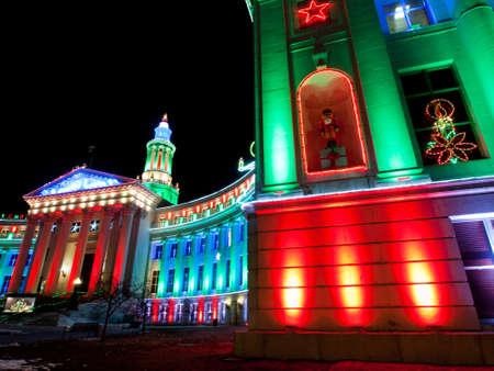 christmas in denver: Downtown Denver at Christmas. Denvers City and County building decorated with holiday lights. Stock Photo