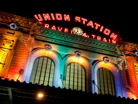Union Station decorated with light for Christmas.