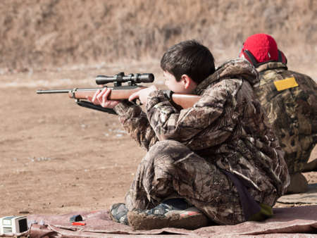 marksmanship: Young boys practicing rifle marksmanship at the Appleseed Project.