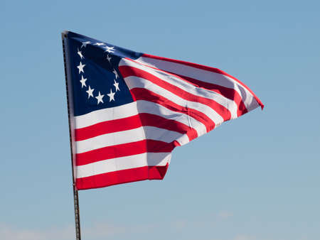 depicted: Original flag of the United States depicted by Betsy Ross.