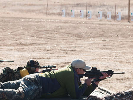 marksmanship: Young boy practicing rifle marksmanship with his father at the Appleseed Project. Stock Photo