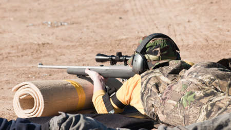 marksmanship: Young boy practicing rifle marksmanship at the Appleseed Project.