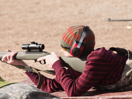 Young boy practicing rifle marksmanship at the Appleseed Project. photo