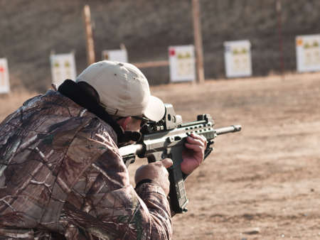 shooting gun: Adult practicing rifle marksmanship at the Appleseed Project.
