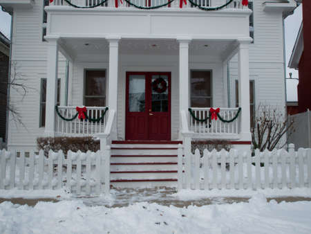 front elevation: House decorated for winter holidays.