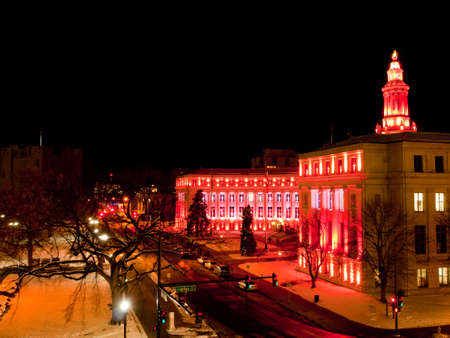 Downtown Denver at Christmas. Denvers City and County building decorated with holiday lights.