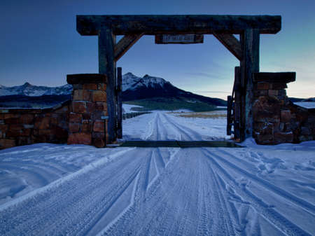 winter road: The Last Dollar Ranch in winter with a view of the Dallas Divide on the back. Stock Photo