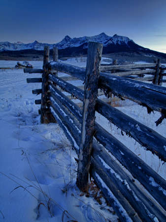split rail: The Last Dollar Ranch in winter with a view of the Dallas Divide on the back. Stock Photo