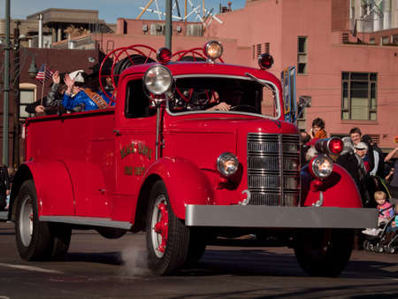 antique fire truck: The 2012 National Western Stock Show Parade, travels up 17 Street in downtown Denver, Colorado.