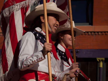 colorado flag: The 2012 National Western Stock Show Parade, travels up 17 Street in downtown Denver, Colorado.