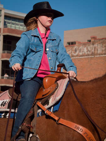 The 2012 National Western Stock Show Parade, travels up 17 Street in downtown Denver, Colorado.