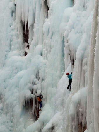 ouray: Alpinist ascenting a frozen waterfall in Ice park, Ouray.