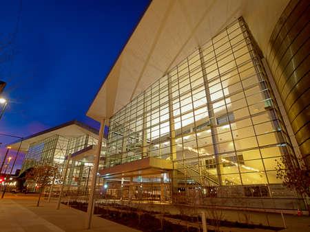 denver skyline at sunset: Colorado Convention Center at blue hour.