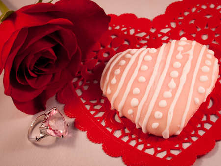 Cookies for Valentine's day on red plate. Stock Photo - 12124002