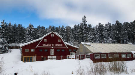 Old red barn after snow storm in Evergreen, Colorado.