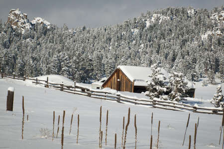 Old barn after snow storm in Evergreen, Colorado.
