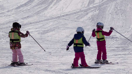 Little girls skiing at Vail, Colorado. Stock Photo - 12445391