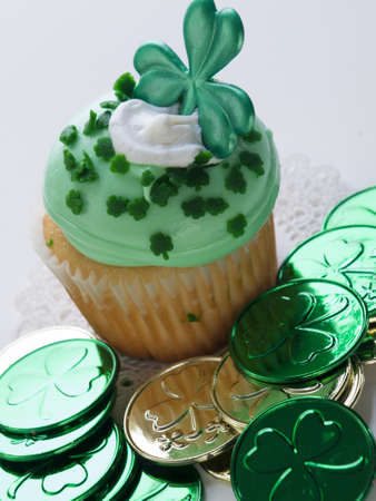 paddys: Decorated cupcakes in a festive St. Patricks day setting with shamrocks.