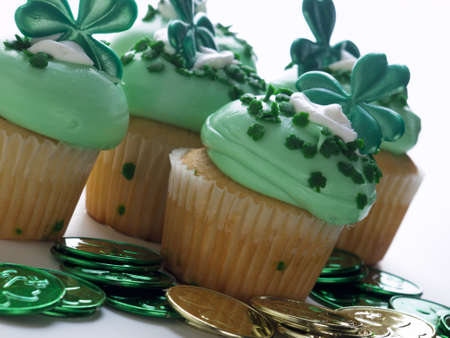 Decorated cupcakes in a festive St. Patrick's day setting with shamrocks. Stock Photo - 12740163