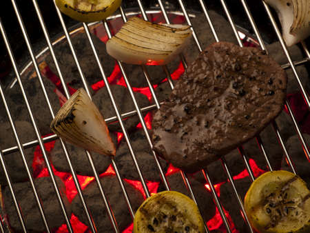 Steak with vegetables cooking on the grill. photo