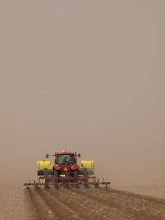 Spring plowing in sand storm near Alamosa, Colorado. photo