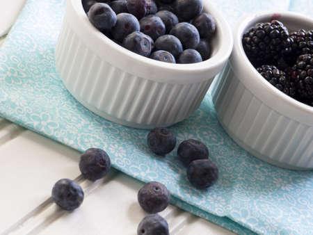 nonfat: Fresh blackberries and blueberries with non-fat greek yogurt. Stock Photo