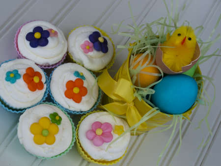 Easter cupcakes decorated with sugar flowers. photo