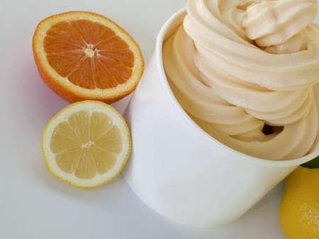 frozen yogurt: Cup of tropical frozen yogurt with fresh fruit.