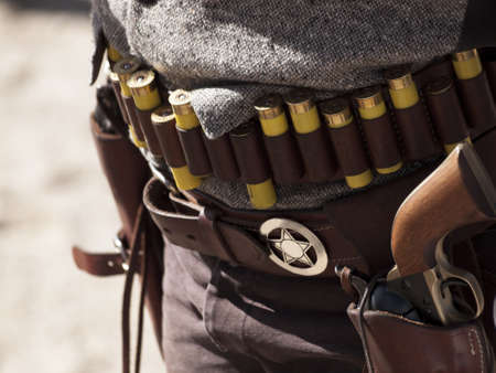 cartridge belt: Cowboy Action Shooting Club. The firearms used are based on those which existed in the 19th century American West, i.e. lever action rifle, single action revolver, and shotgun.